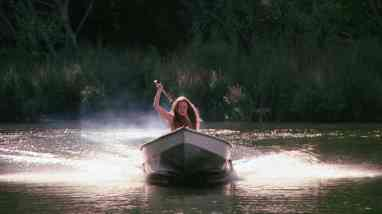 Jennifer (Camille Keaton) Paddling for safety in I Spit on Your Grave.