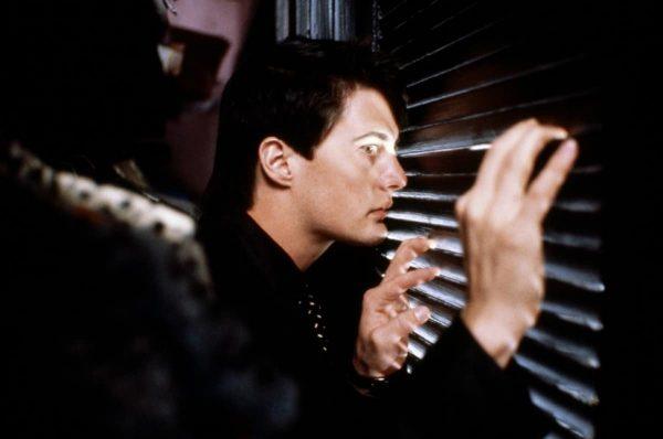 Kyle MacLaughlan hides in a coat closet in Blue Velvet (1986)