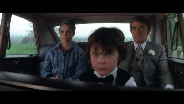 He's a bad, bad boy. Harry Stephens, Gregory Peck, and Lee Remick in The Omen (1976)