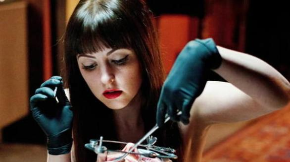 Katherine Isabelle doing surgery in American Mary (2012)