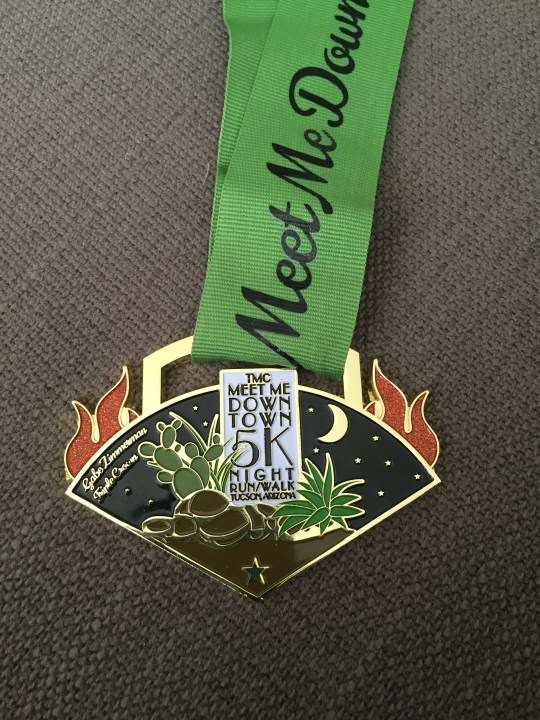 The medals for this three-race series all fit together to form one larger medal. One down, two to go!