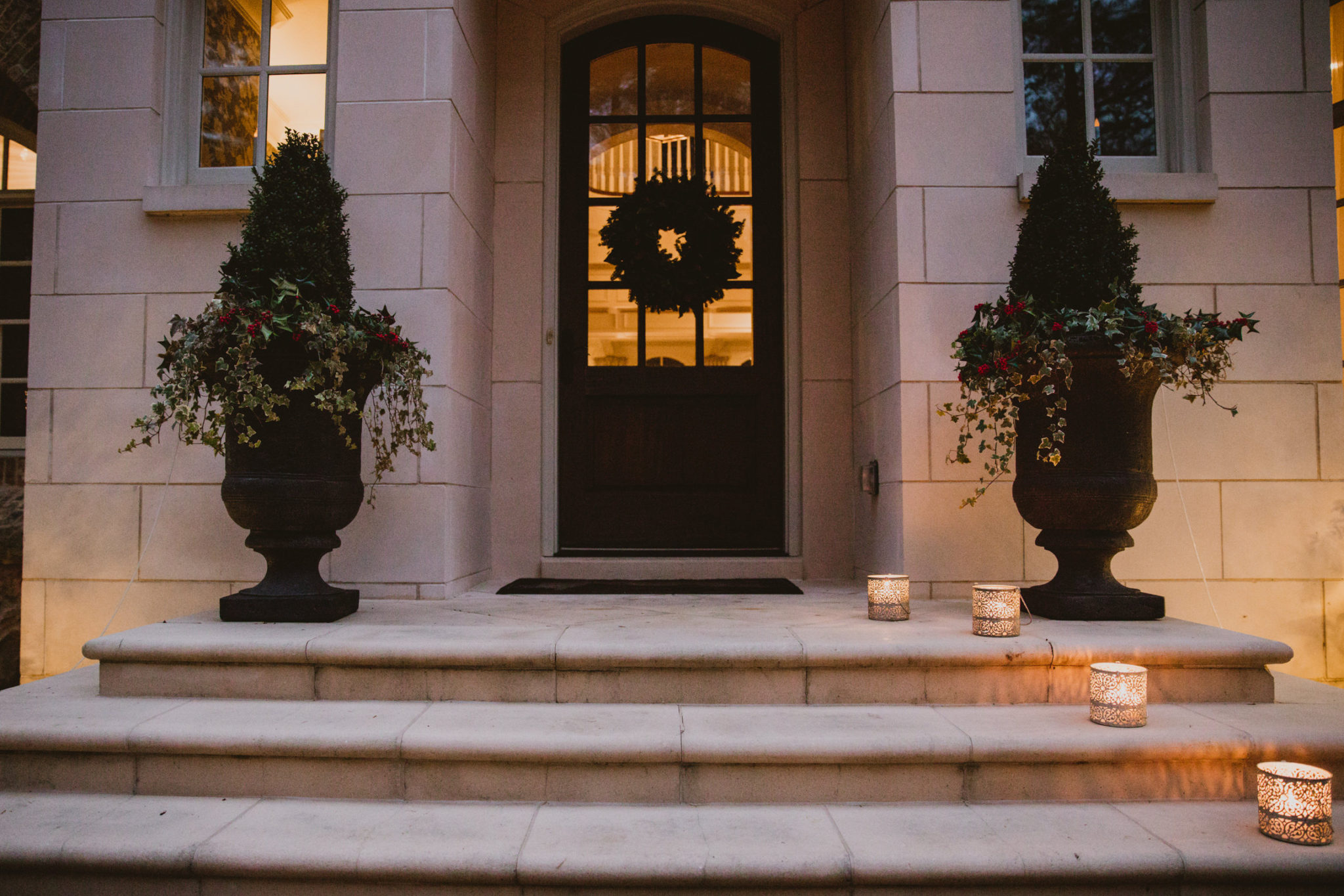 Christmas luminaries on front steps