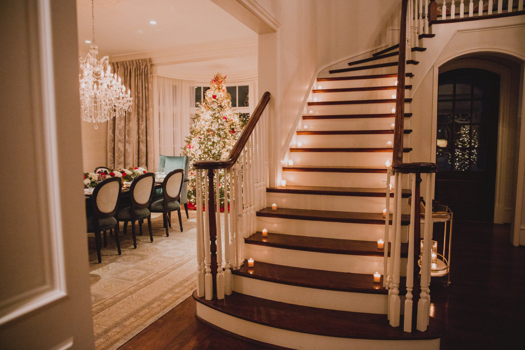 beautiful Christmas home entry with lit staircase