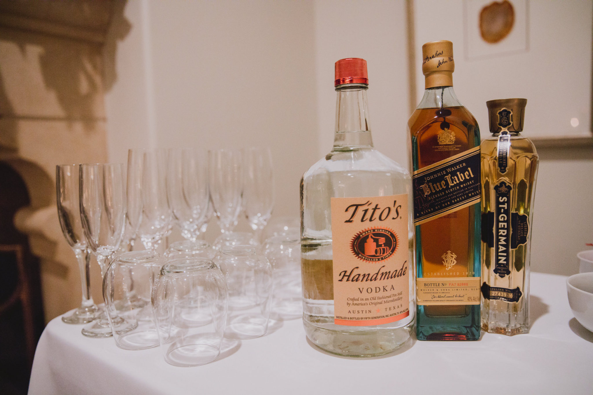 cocktail cart featuring Tito's handmade vodka, Johnnie Walker blue label, and St-Germain