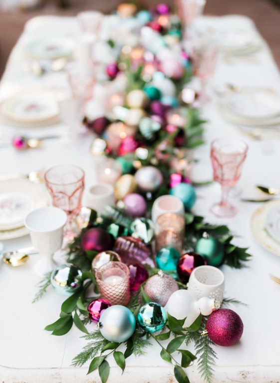 jewel toned Christmas or holiday table centerpiece, featuring pink and aqua ornaments