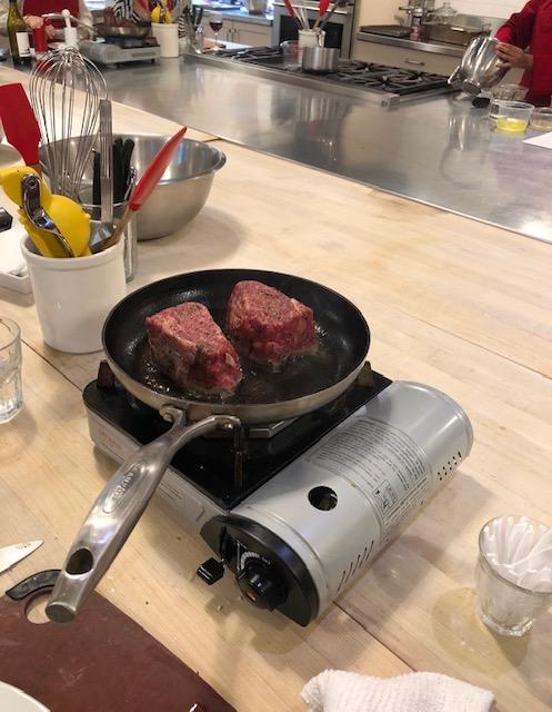 searing filet mignon at Sur La Table