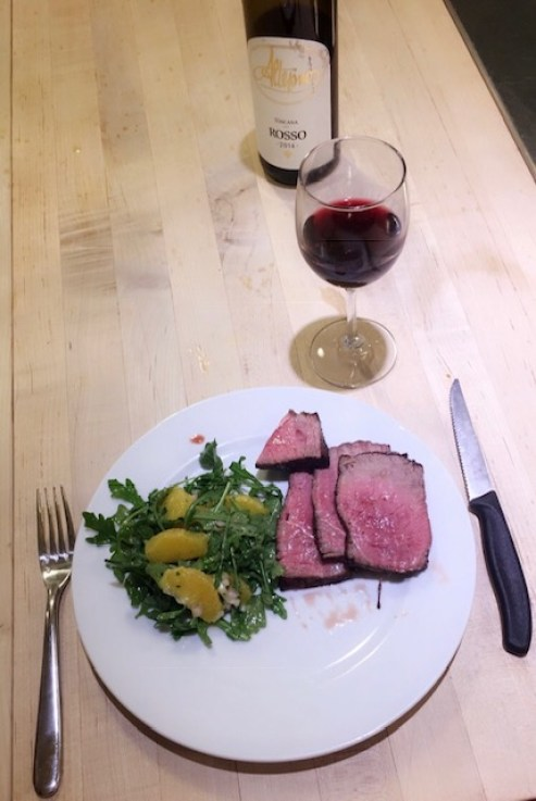 filet mignon, arugula salad, and wine
