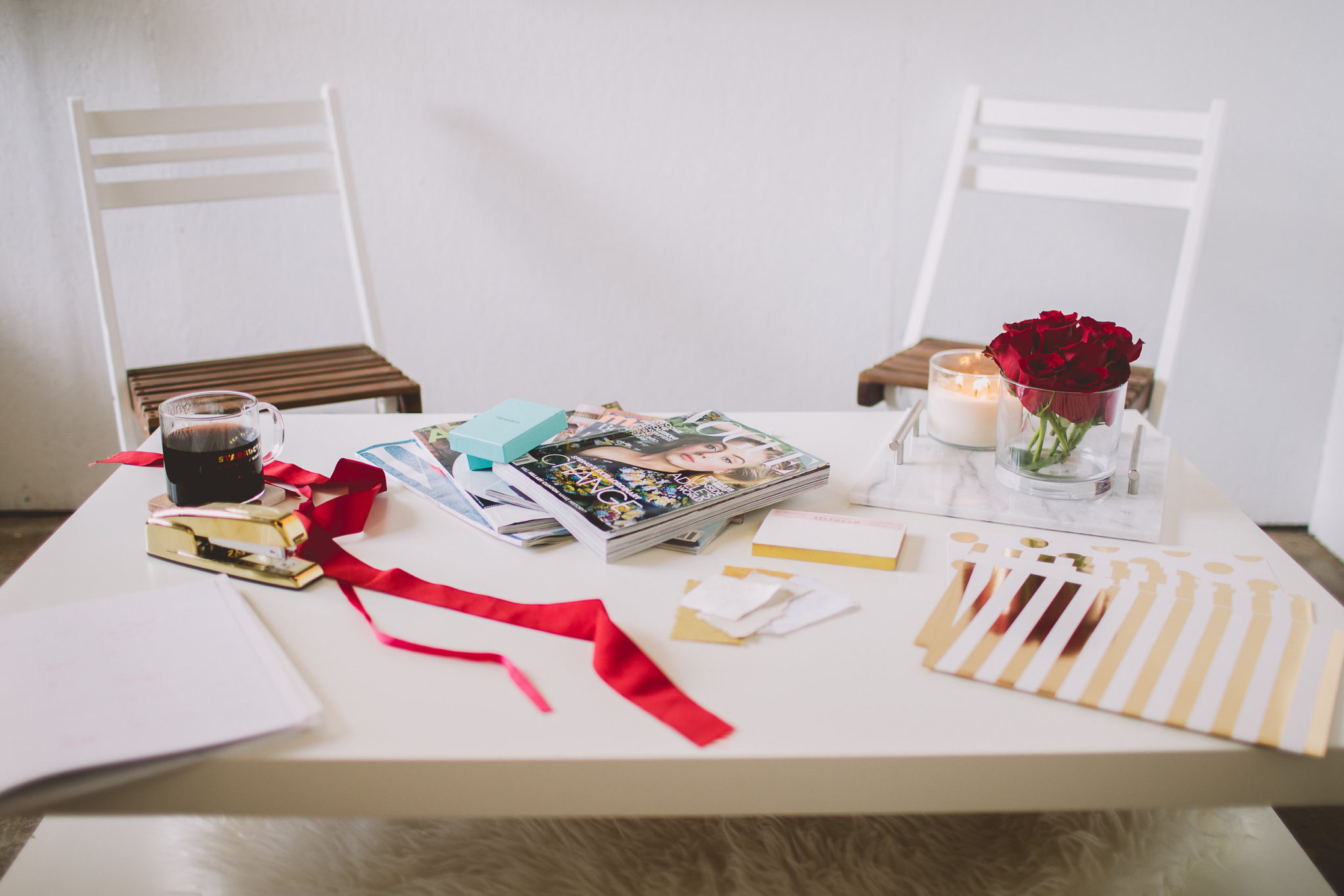 event planner table beautifully styled with red and white accents
