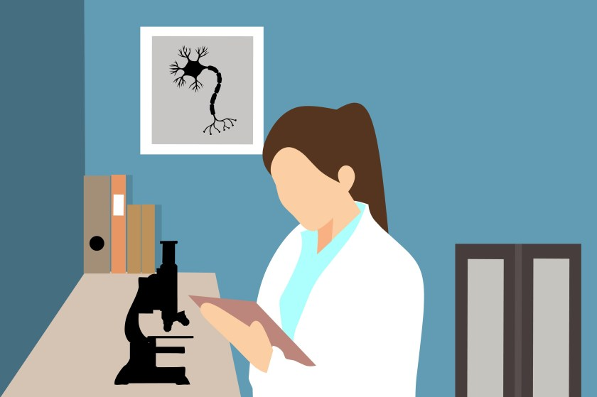 female scientist holding a clipboard standing in a laboratory in fornt of a microscope. Books and pictures of neurons line the wall behind her