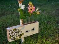 https://scavengerdesigns.wordpress.com/2013/03/09/whats-new-unique-flower-holders/