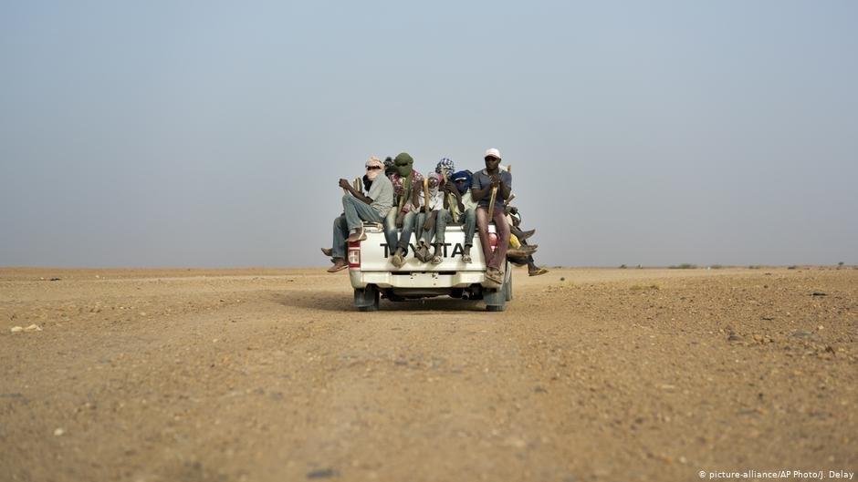 Des migrants expulsés retrouvés par l'OIM.   Photo: picture-alliance/AP Photo/J. Delay