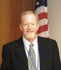 Mark W. Binkley, JD, Interim State Director