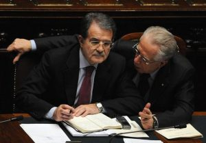 Italian Prime Minister Romano Prodi (L) listens to Economy Minister Tommaso Padoa Schioppa during discussions at the lower house of the parliament before the vote of confidence in Rome 23 January 2008. Prodi put his political survival on the line, calling for a vote of confidence in his center-left government after 20 months in power. The crisis was sparked when centrist Clemente Mastella resigned as justice minister last week and said his small UDEUR party would oppose Prodi in a vote of confidence. UDEUR's three votes have been crucial in the Senate, where the government's survival will now depend on the support of left-leaning senators-for-life, who have cast crucial votes on several occasions to prop up the centre-left. AFP PHOTO / ALBERTO PIZZOLI (Photo credit should read ALBERTO PIZZOLI/AFP/Getty Images)