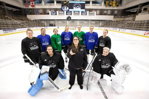 Jami Cohen '15 throws a puck into the air with the Buffalo Beauts