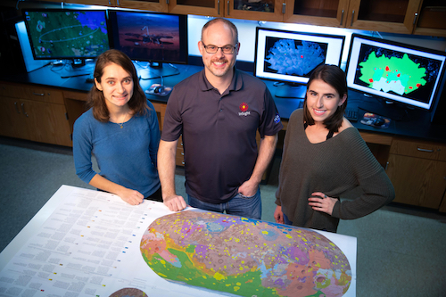 Assistant Professor Nick Warner and two students in the planetary geology lab at Geneseo.
