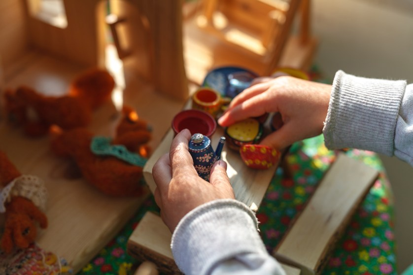 A child uses colorful coins.