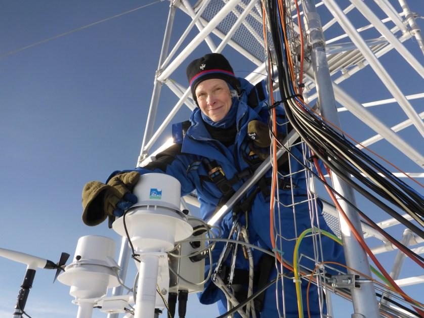 Dana Veron checks equipment in a parka in Antarctica