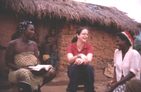 Danielle Ellingston '97 with a family in Ghana.