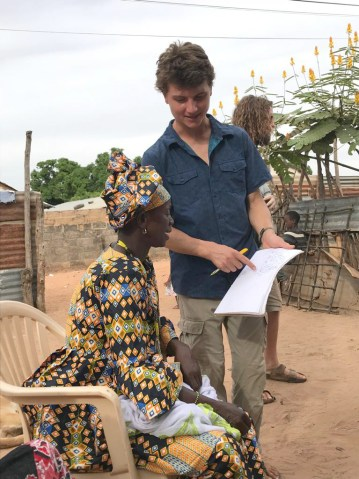 Declan Dwyer-McNulty '17 in the Gambia talking to a woman