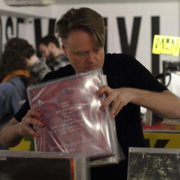 Simon restocking the vinyl