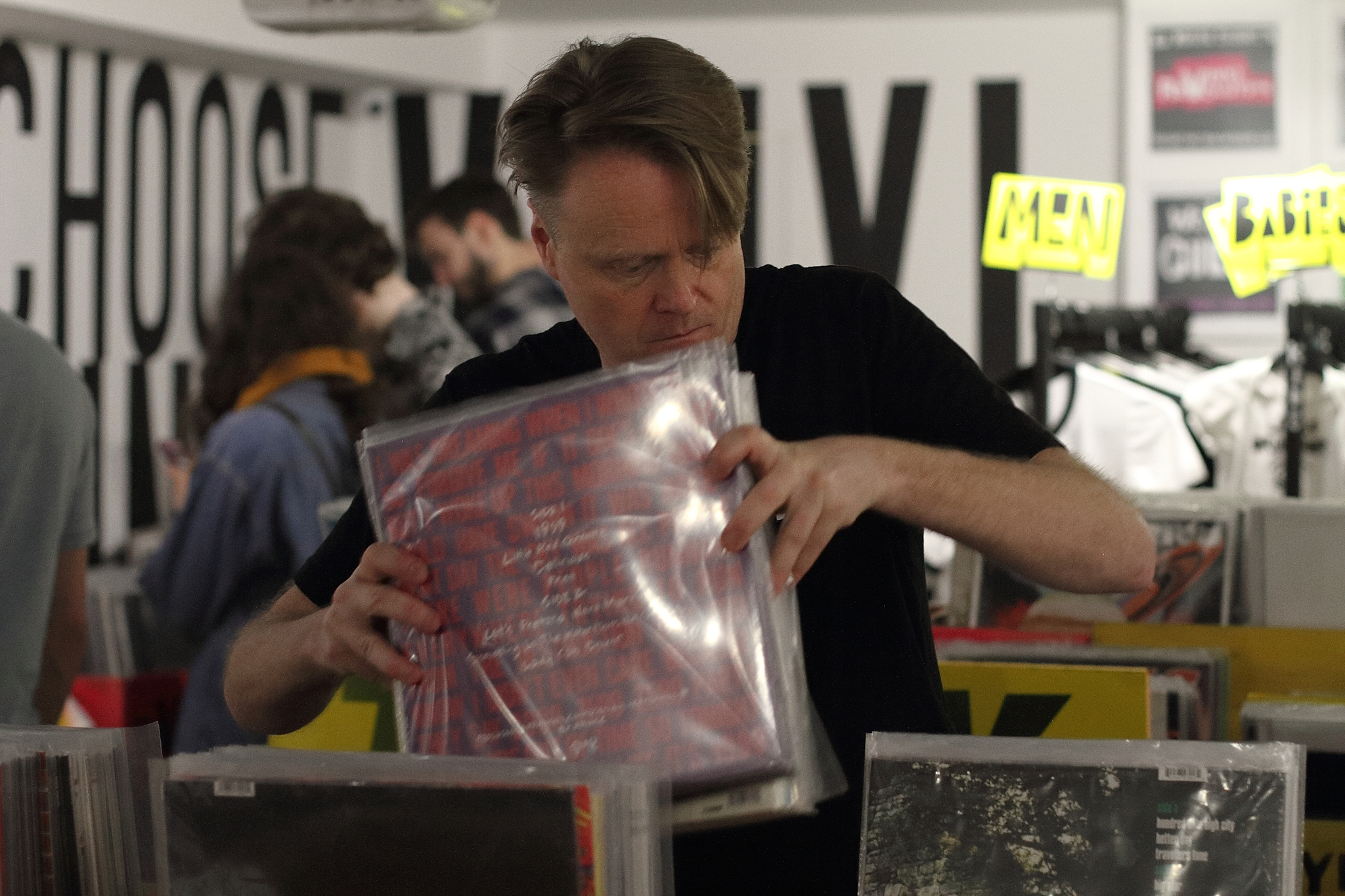 Simon restocking the vinyl