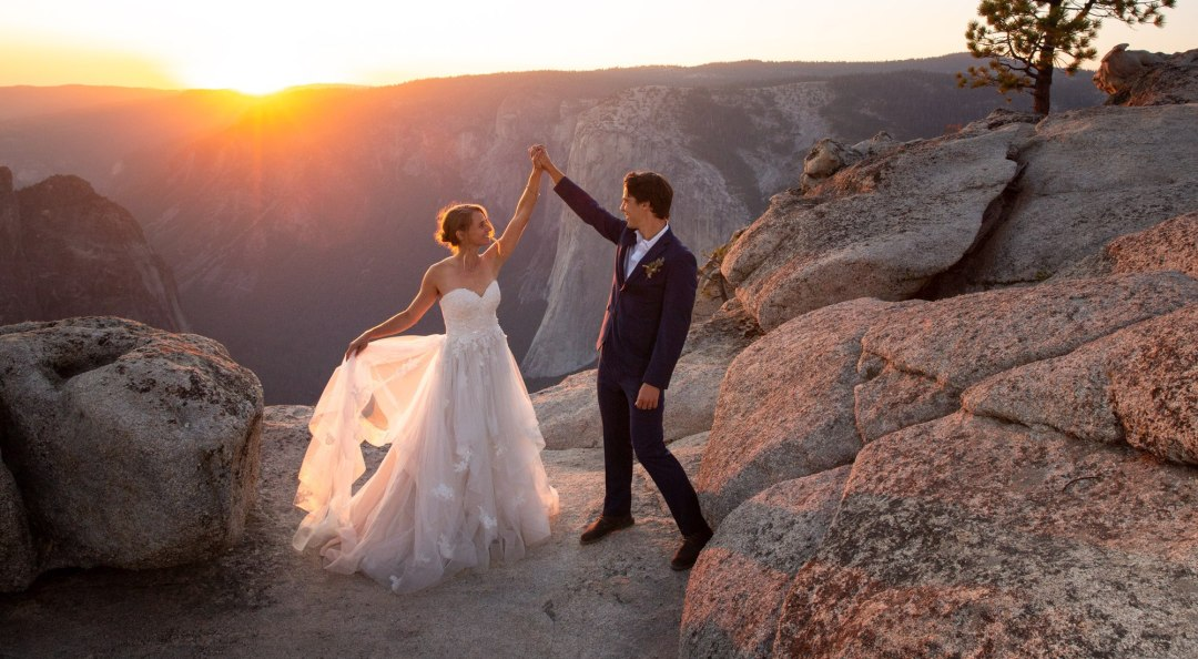 High Fives after a beautiful sunset elopement on Taft Point Yosemite