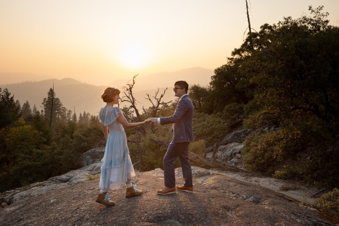 Newlyweds dance in a smoky sunset.  They sure didn't let the forest fires get in the way of their elopement ideas!
