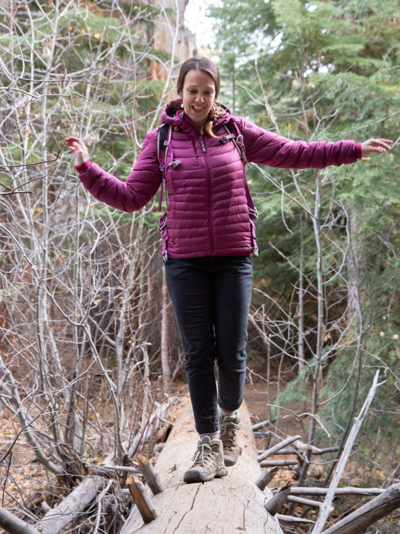 Becky tests her balance on a fallen tree.
