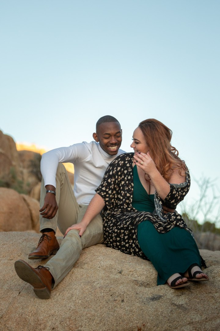 Couple sitting and smiling during a Joshua Tree photo session