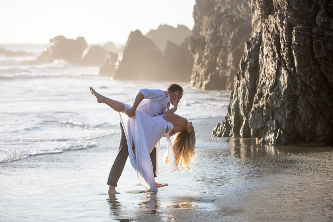 Groom dips bride during the first dance of their Oregon Coast Elopement