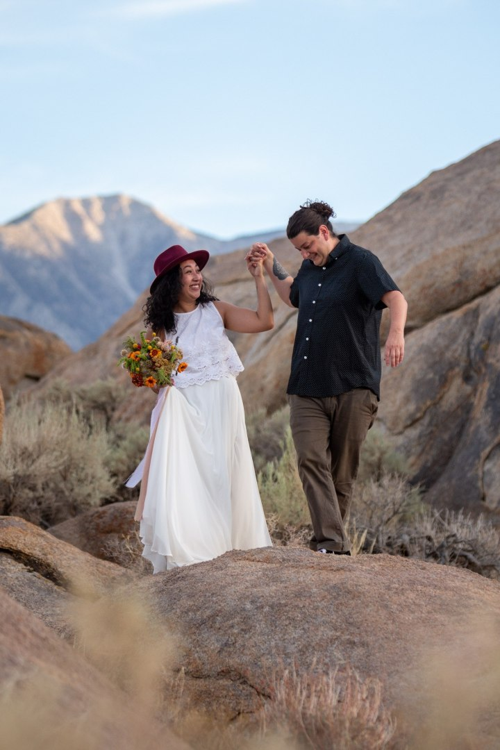 Dancing along the rocks in the California Hills after saying their wedding vows.