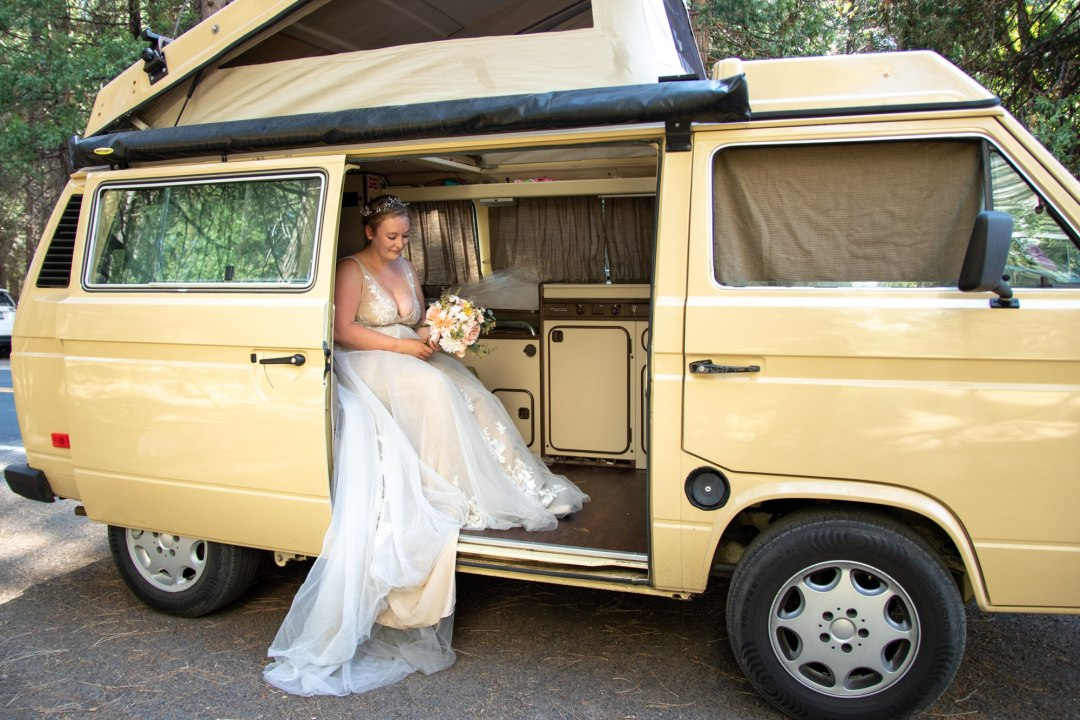 Bride sitting in VW van just after getting hitched in Yosemite!