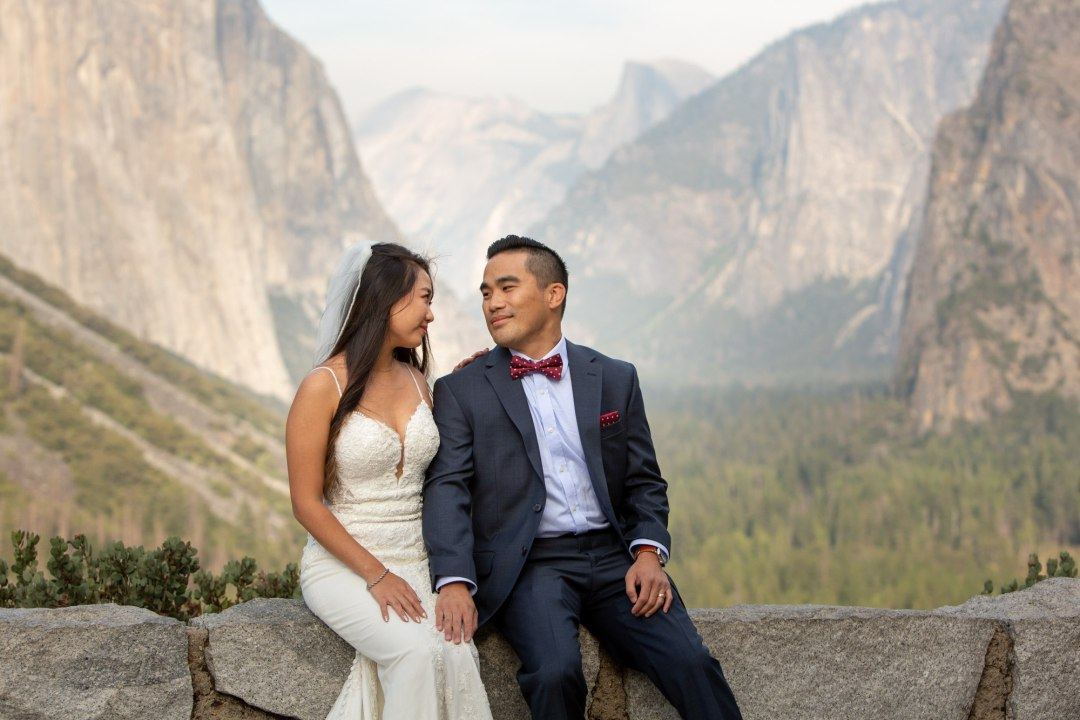 Newlyweds hanging out at Tunnelview after their Yosemite elopement