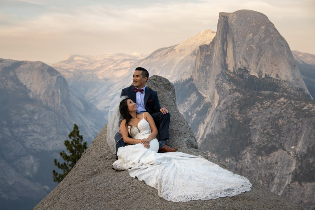 Bride looks p lovingly at groom after the Glacier Point Elopement in Yosemite.