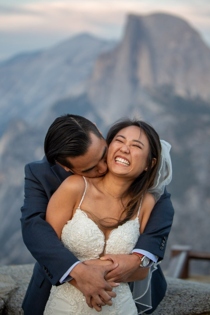 Groom hugging his new wife after their Yosemite elopement!