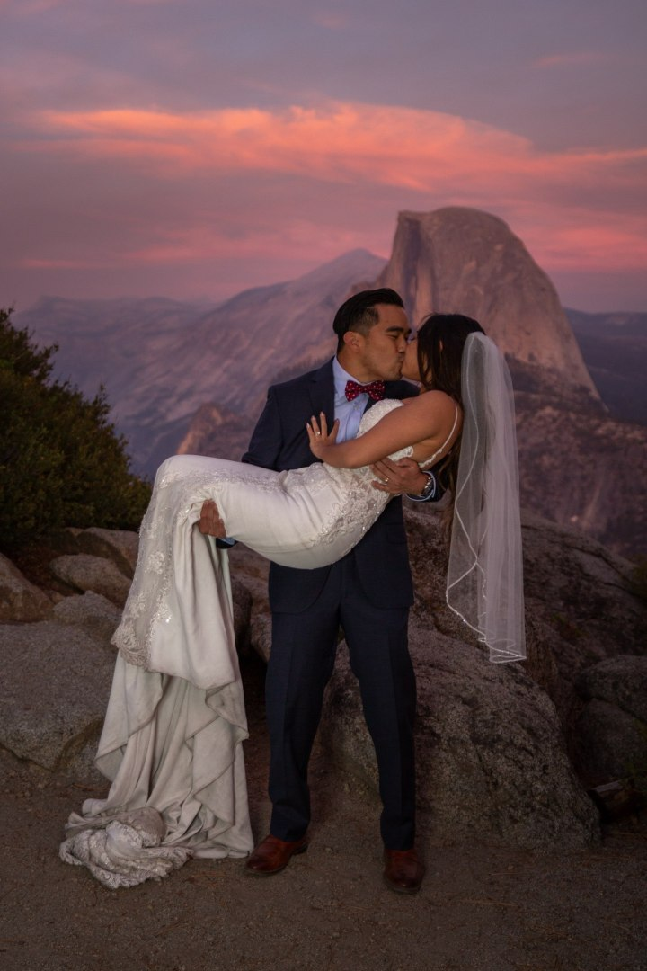 Bride holds and kisses bride at the end of an awesome Yosemite intimate wedding!