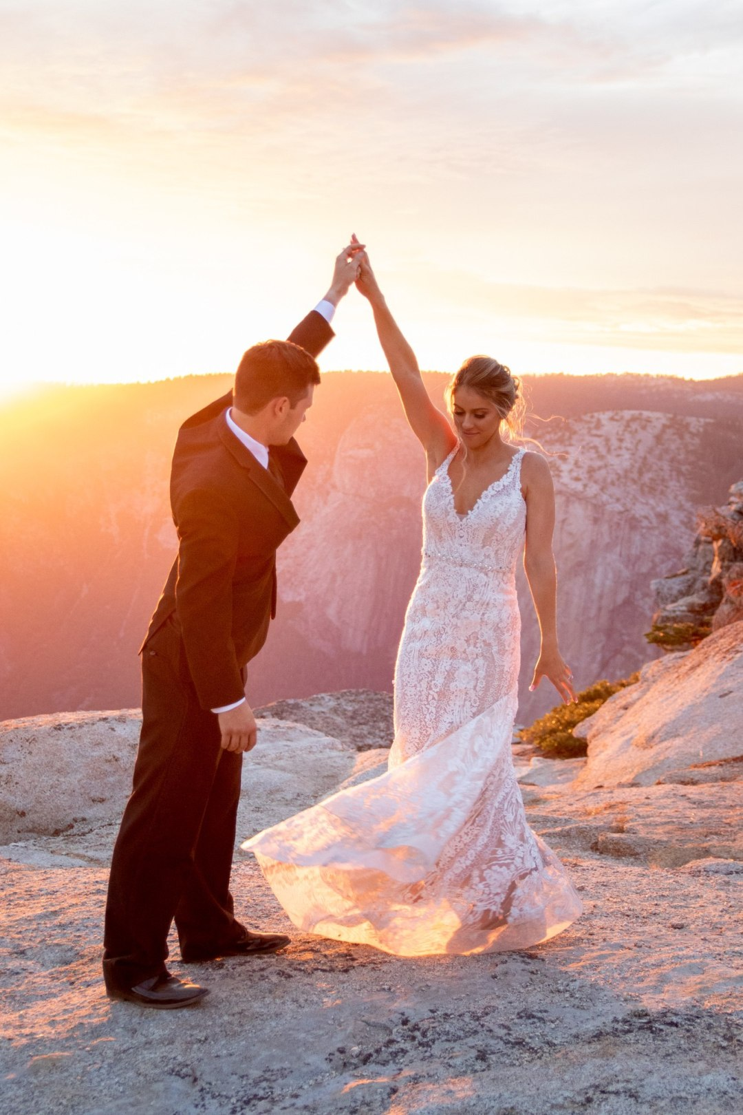 Beautiful golden sunset for this bride and grooms first dance on Taft Point, Yosemite.