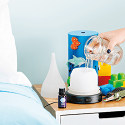 woman adding water into the deep blue sea diffuser