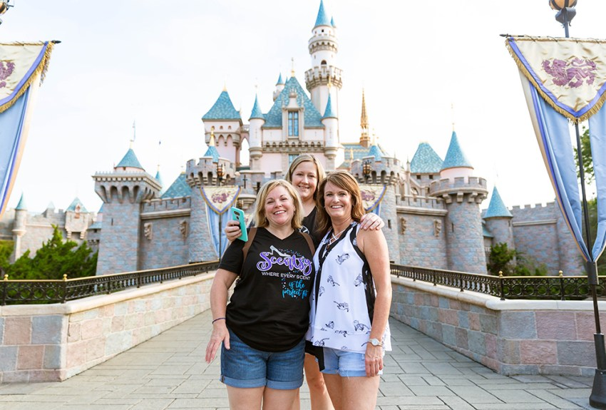 photo of consultants during Scentsy Family Reunion in front of Cinderella's castle in Disneyland