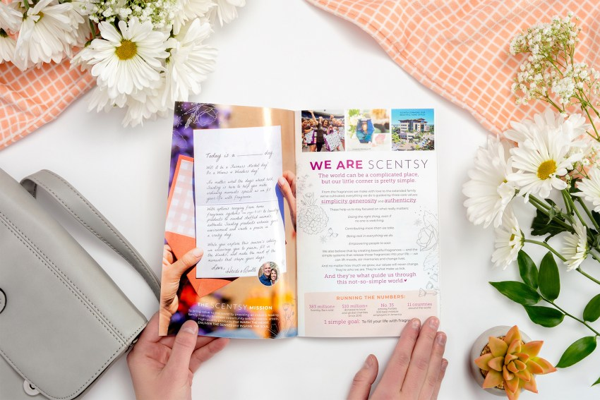 consultant flipping through new spring summer 2019 catalog