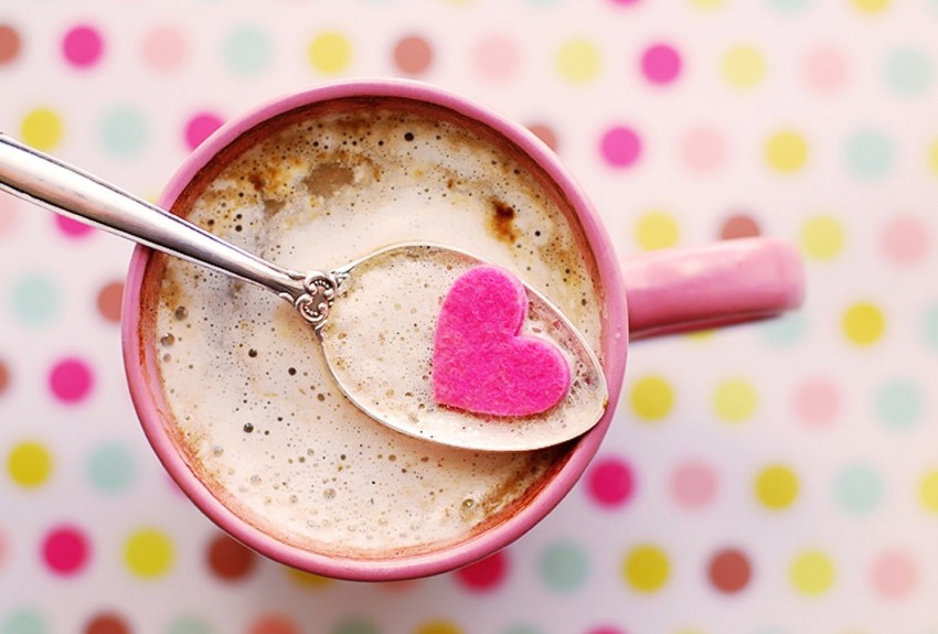 chocolate with heart floating atop the drink