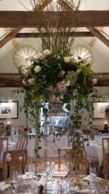 Urn flower table arrangement