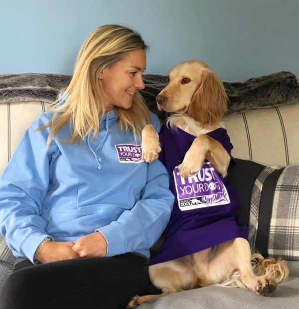 scentwork clothing modelled by blonde woman and cocker spaniel