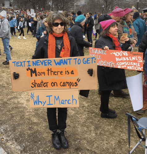 Mother holds placard at Boston March for our Lives