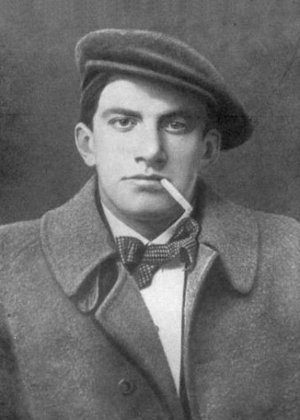 The young poet, Mayakovsky, 1915 with rakish hat and cigarette drooping from the corner of his mouth