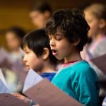 Children singing from song sheets; image Royal Conservatoire of Scotland, photographer Robert McFadzean