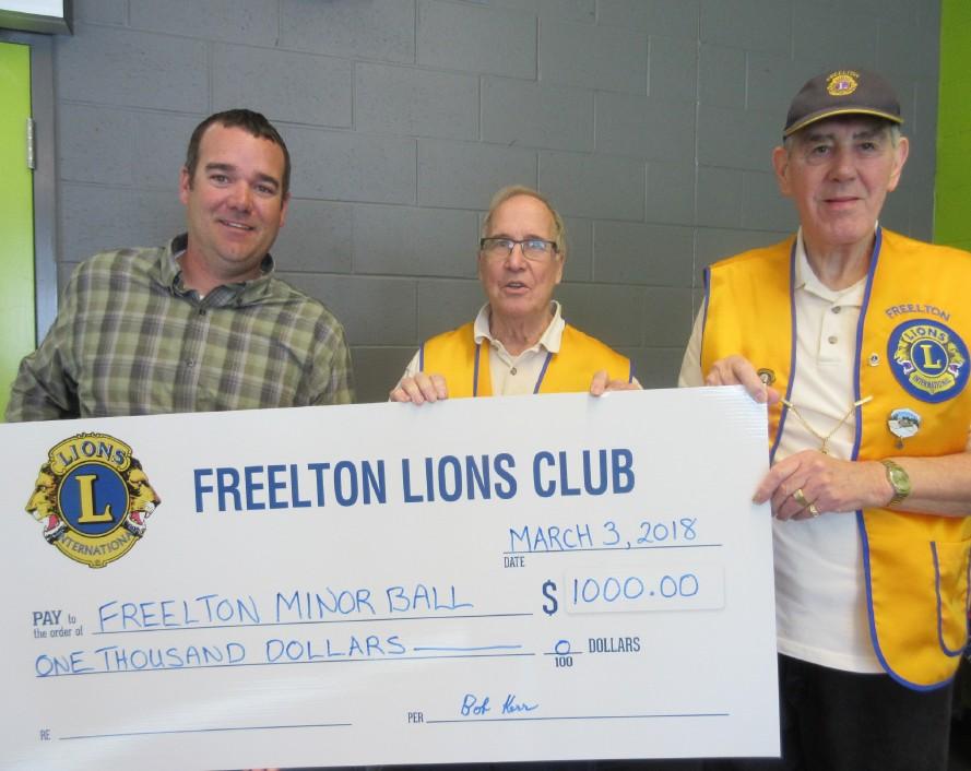 Freelton Lions present a cheque to Freelton Minor Ball Association