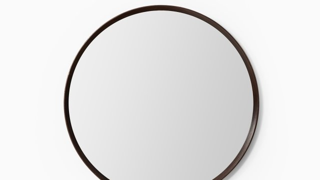 Large round mirror in rosewood at Studio Schalling