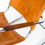 Rocking chair in chromed steel and cognac brown leather at Studio Schalling