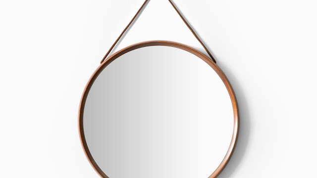 Uno & Östen Kristiansson round mirror in teak at Studio Schalling